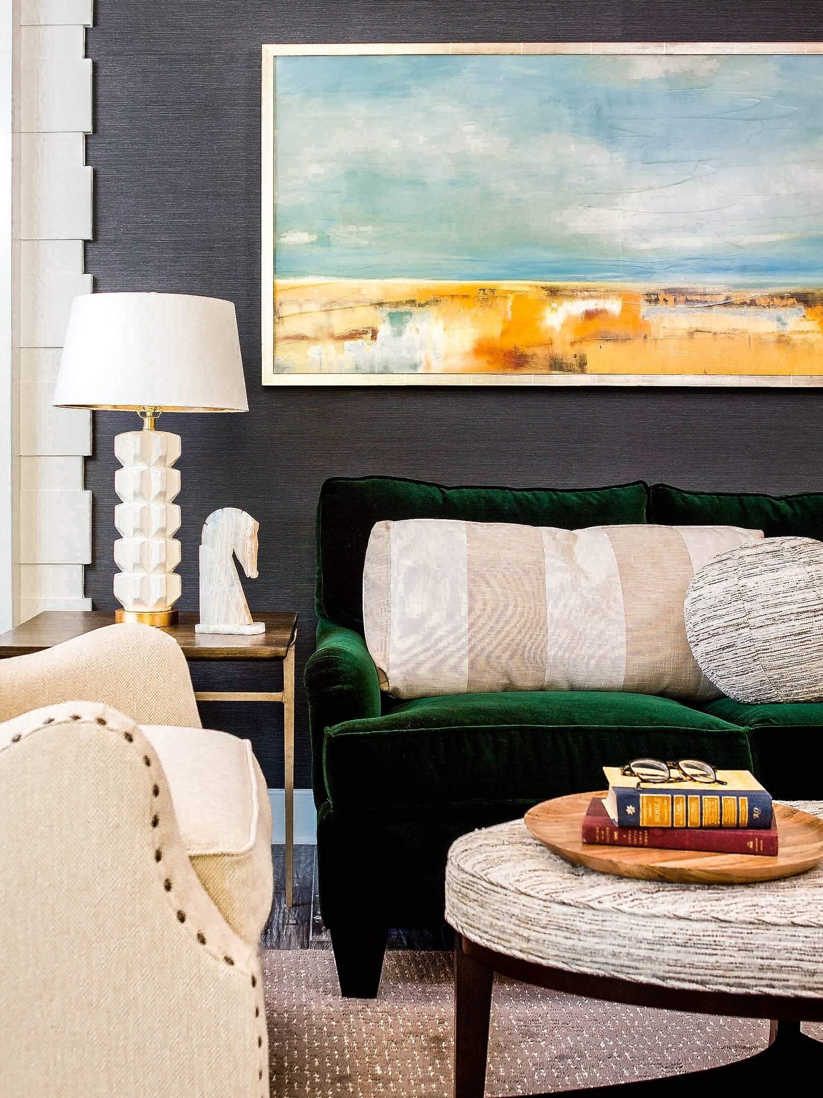 When it was time for a change, we chose texture over pattern, but the dark charcoal color of this paper still provided that focal point contrasted with the bright molding. Plus, this wall covering is vinyl!