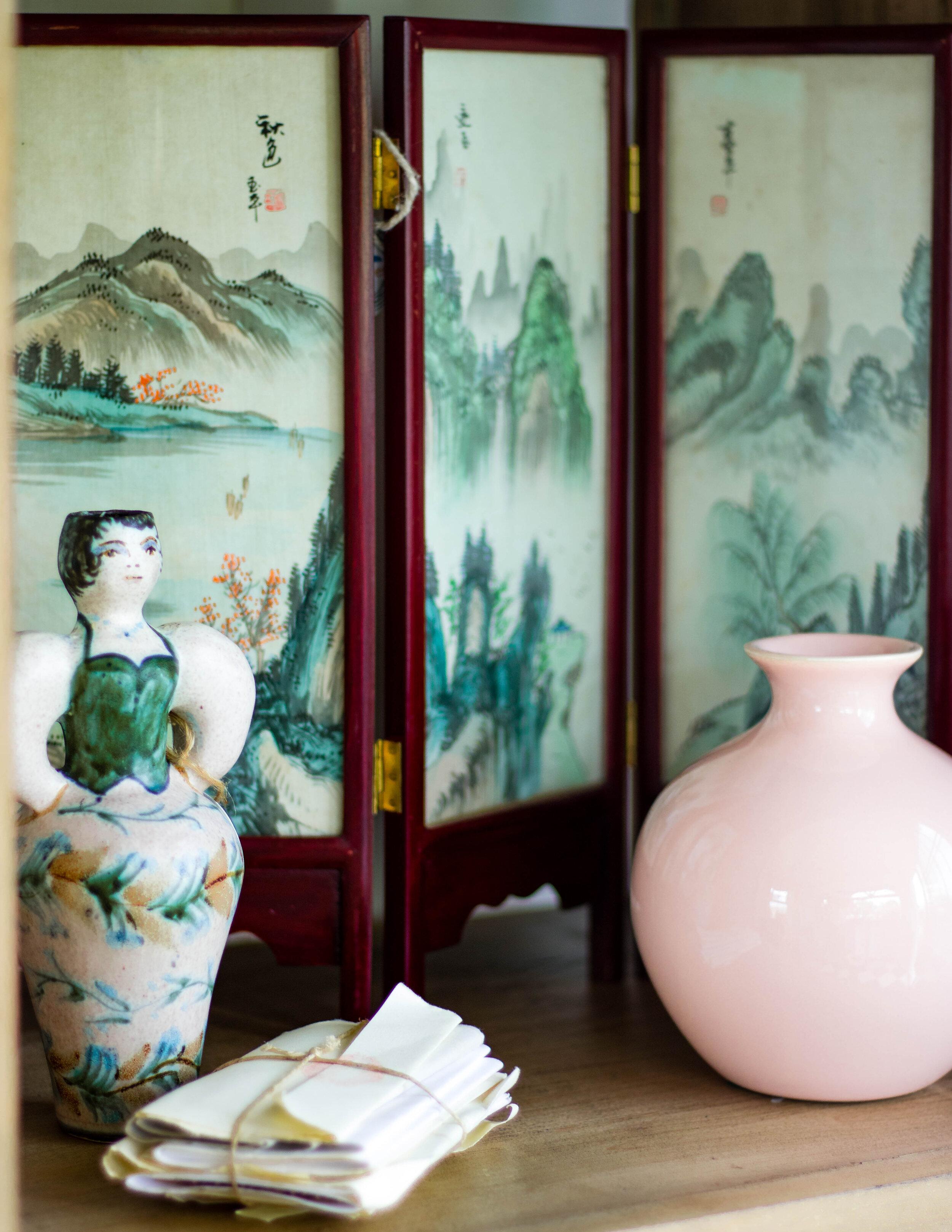 Vintage vases on a shelf in our She-Shed design.