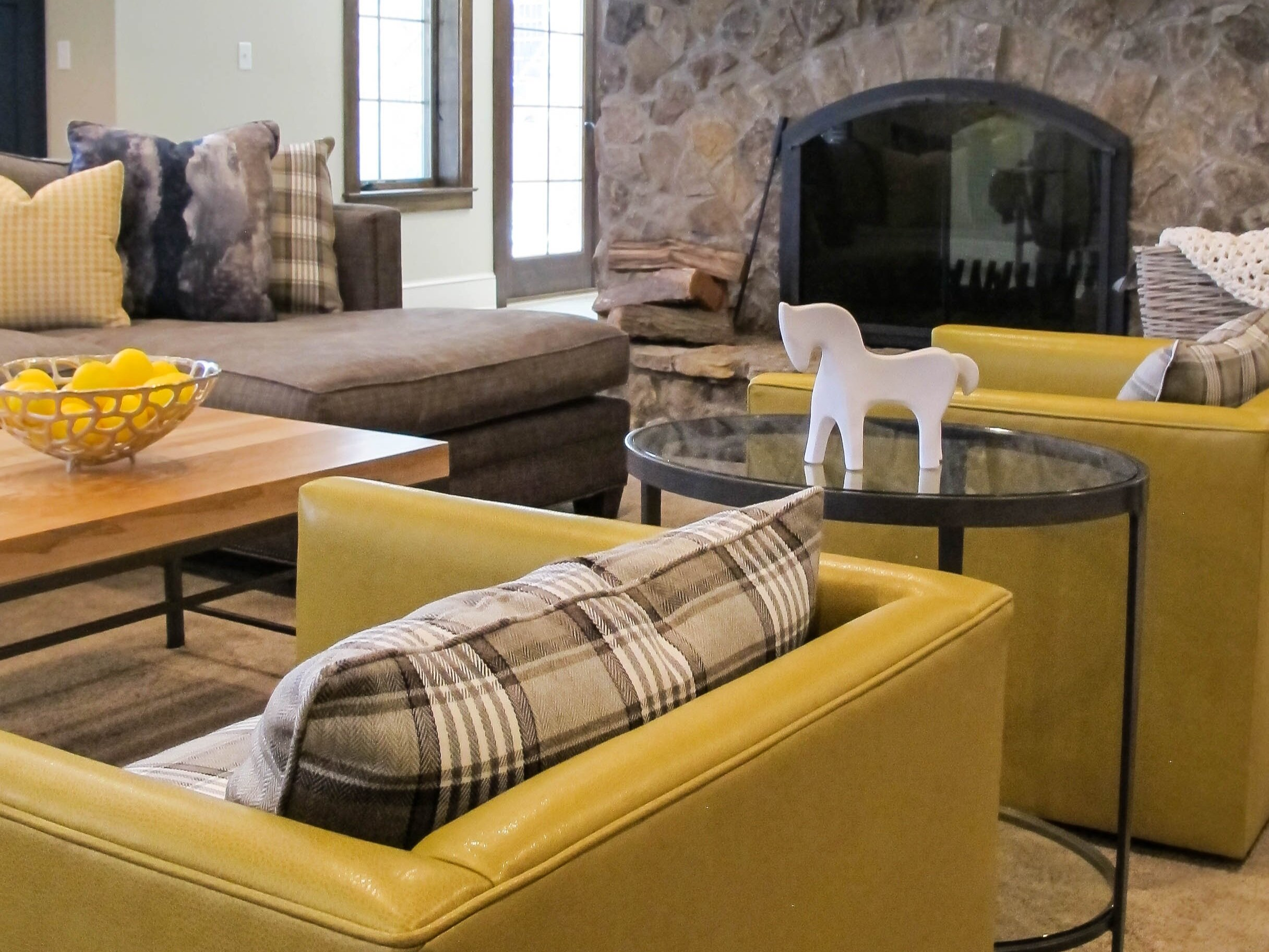On the lower level living space of our Stonecleft project, we took pops of yellow and unexpected finishes and created a family friendly yet stylish retreat.