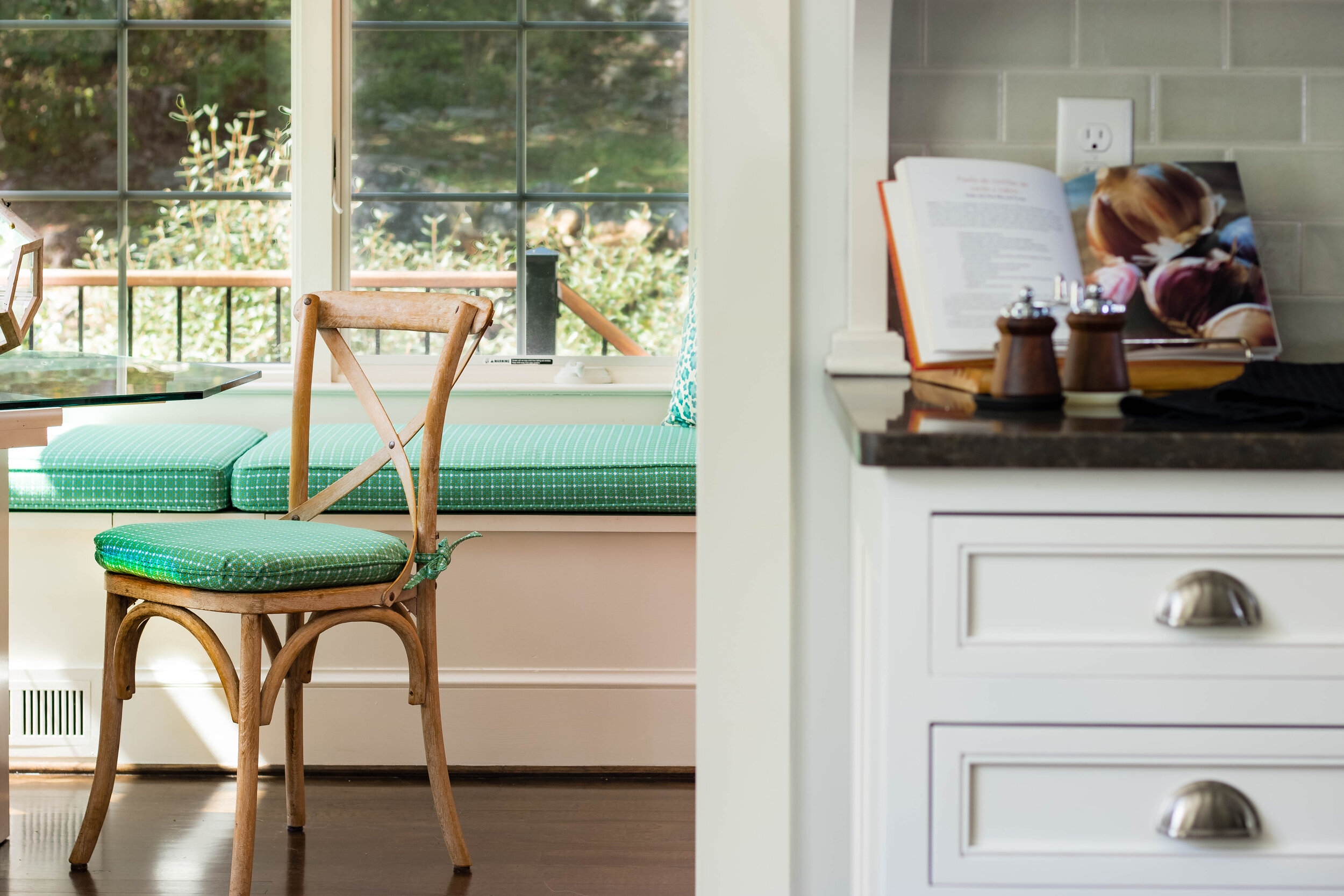colorful-kitchen-design-with-breakfast-nook-french-chair-custom-window-seat
