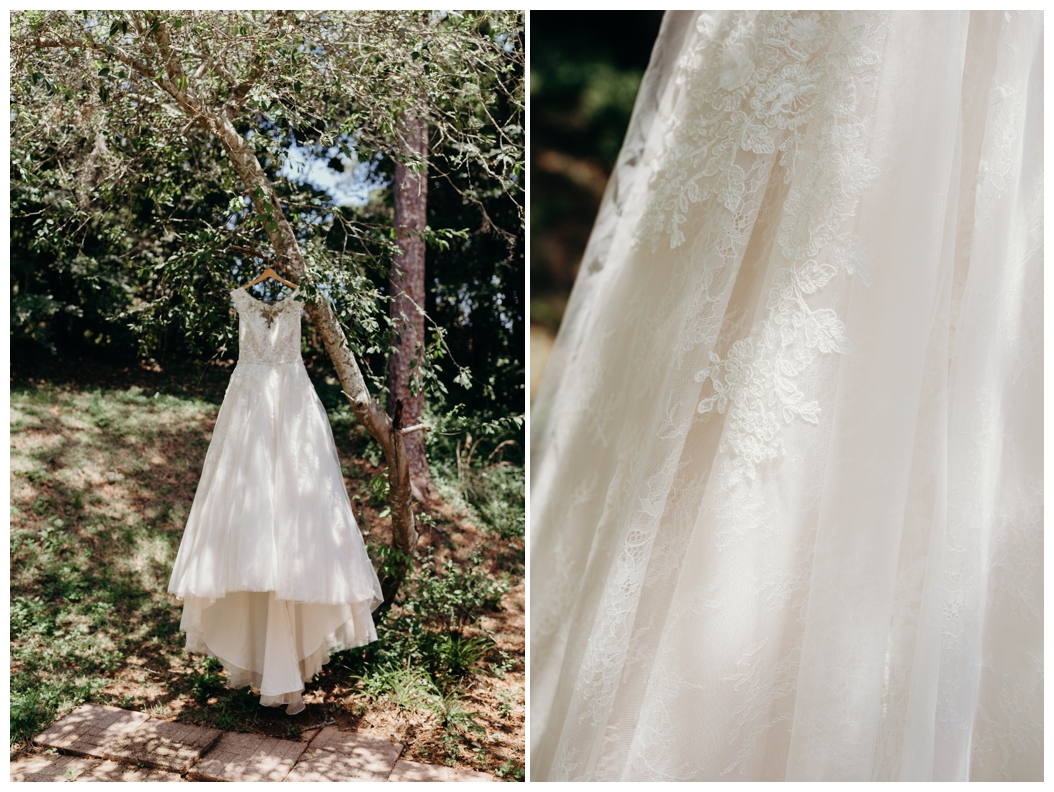 lace wedding dress hanging from tree