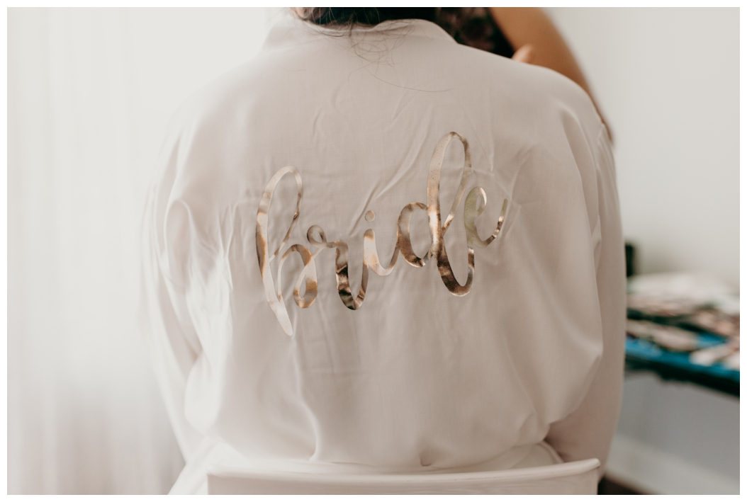 white bride robe with gold letters