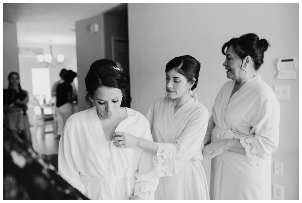 bride with her mother and bridesmaid