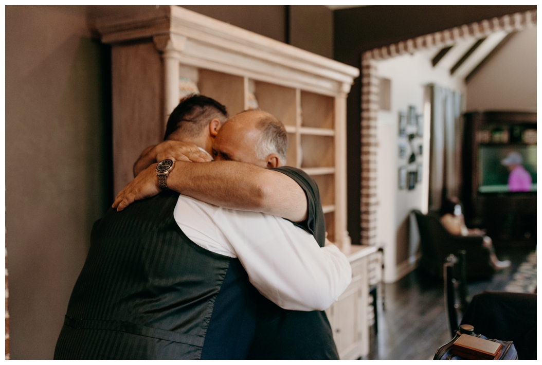 emotional picture of groom with relative
