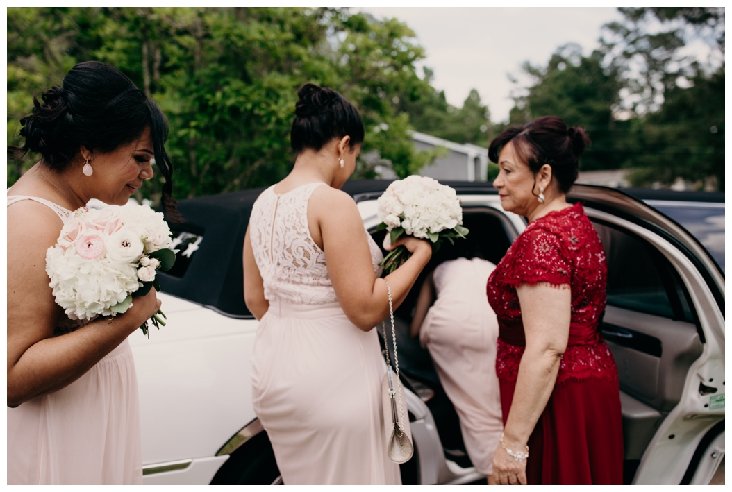 bridesmaids getting into a limo