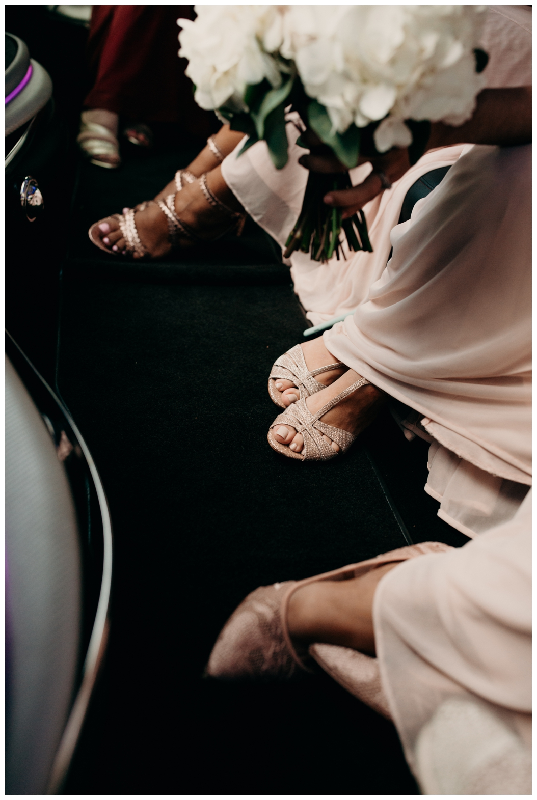 bridesmaids shoes inside a limo