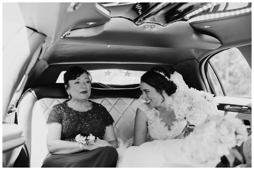 bride and her mother inside of a limo