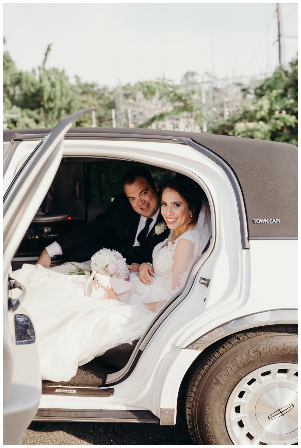 bride and groom in limo in Tallahassee