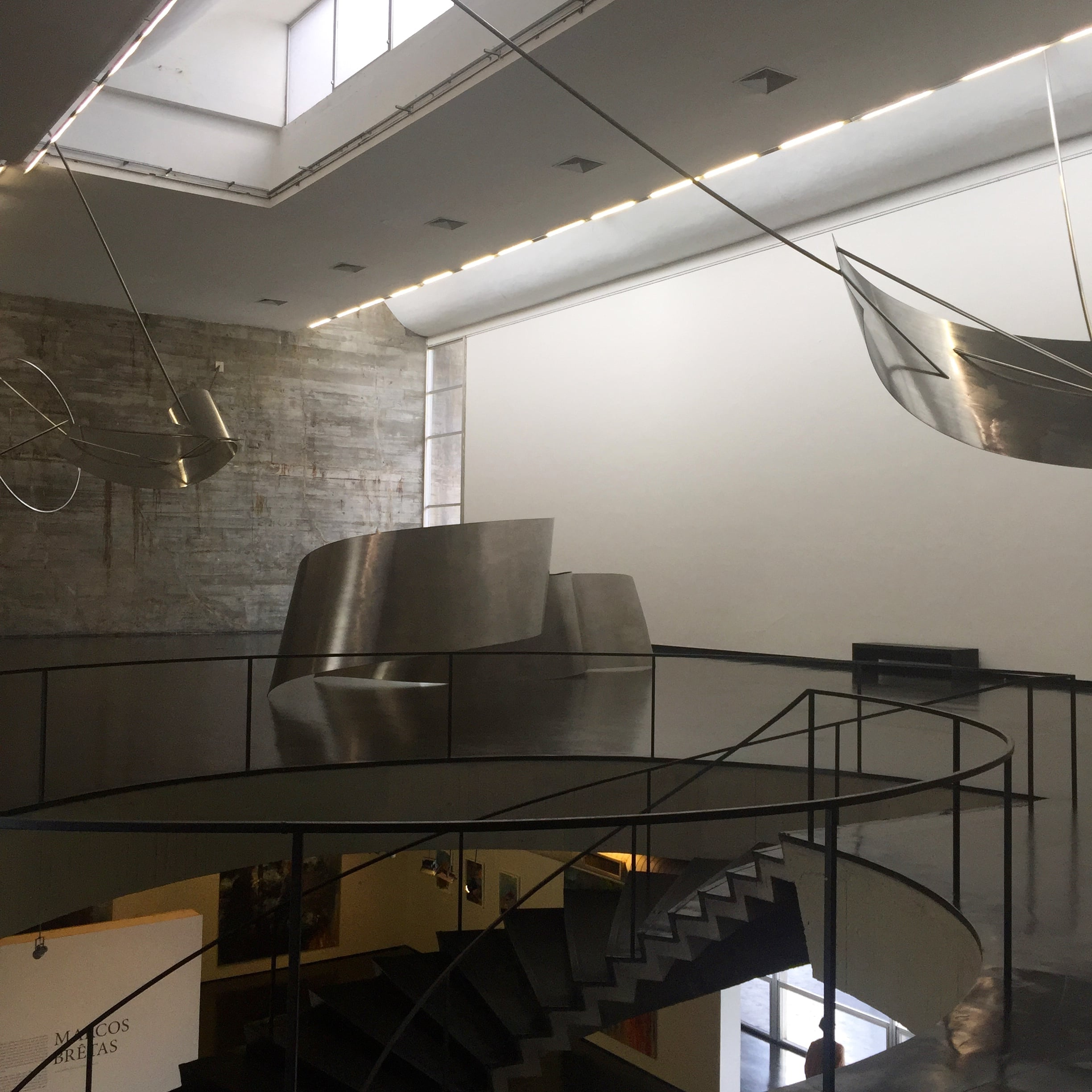 Large metal sculptures fill the first room on the second floor