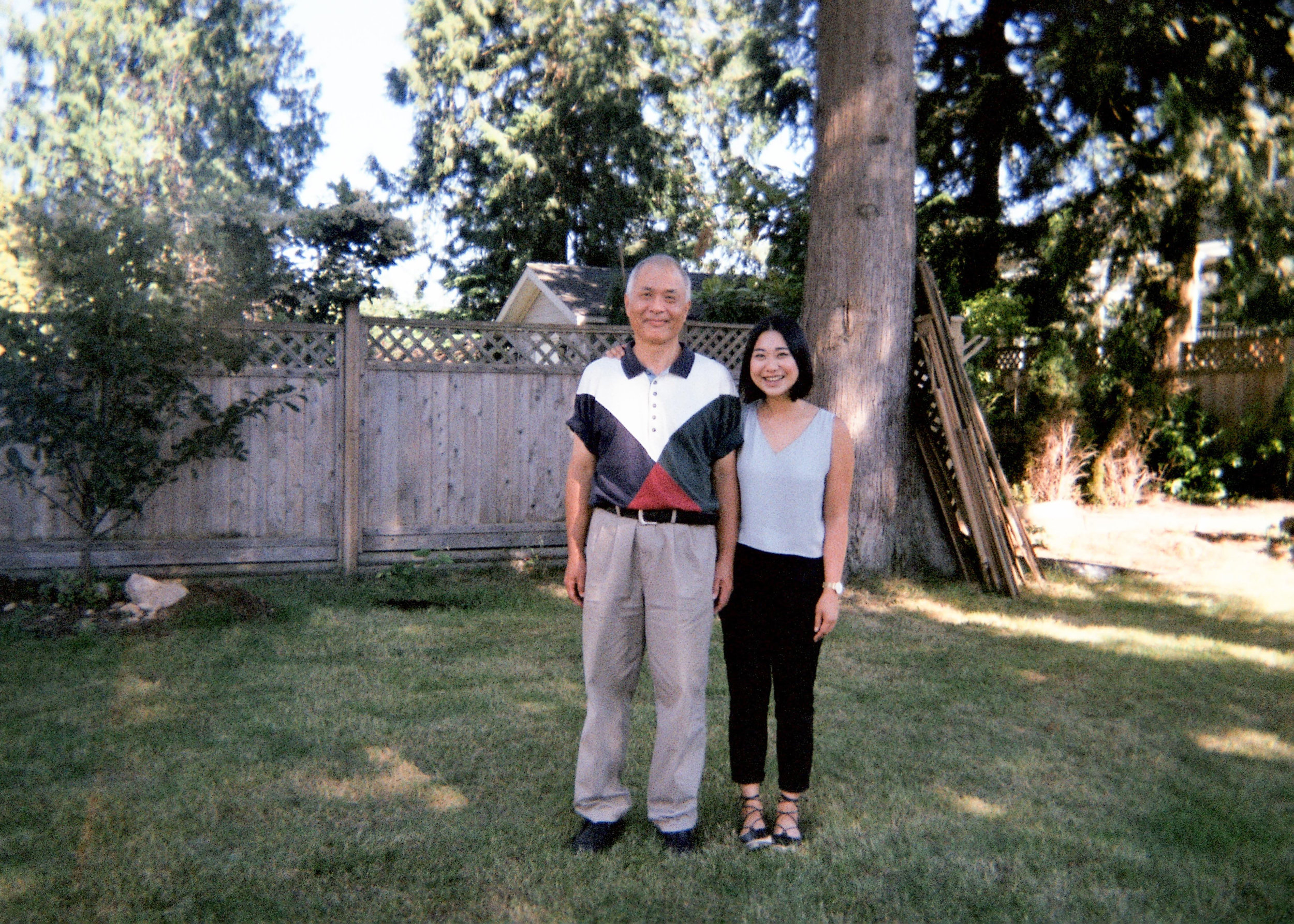 A photo of me and Papa in his yard. Shot on film in 2017.