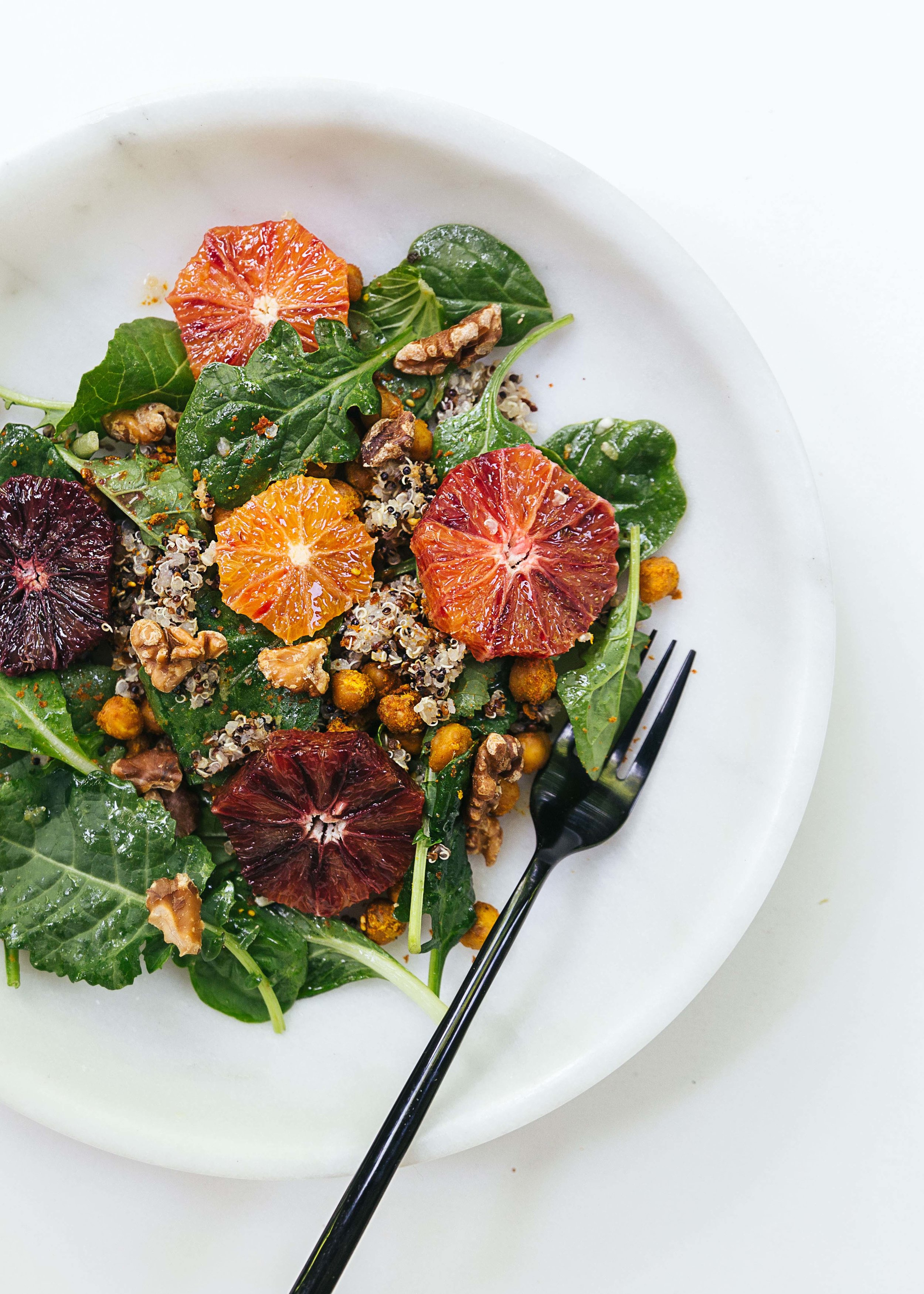 my vancouver salad: quinoa, roasted chickpeas, baby spinach, walnuts, blood orange. lemon juice, zest and olive oil dressing