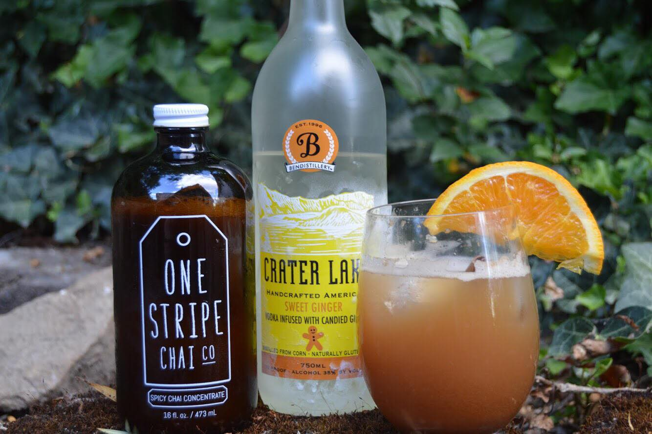 Chai & Ginger - 2 ounces One Stripe Chai Spicy Chai Concentrate1 oz Sweet Ginger Crater Lake VodkaJuice of 1/4 of an orange (squeezed)Mix concentrate, vodka, and orange juice in cocktail shaker and shake it like you mean it.Pour over iceTop off with tonic waterAdd cinnamon stick and garnish with orange wedgeRecipe submitted by Stephen E.