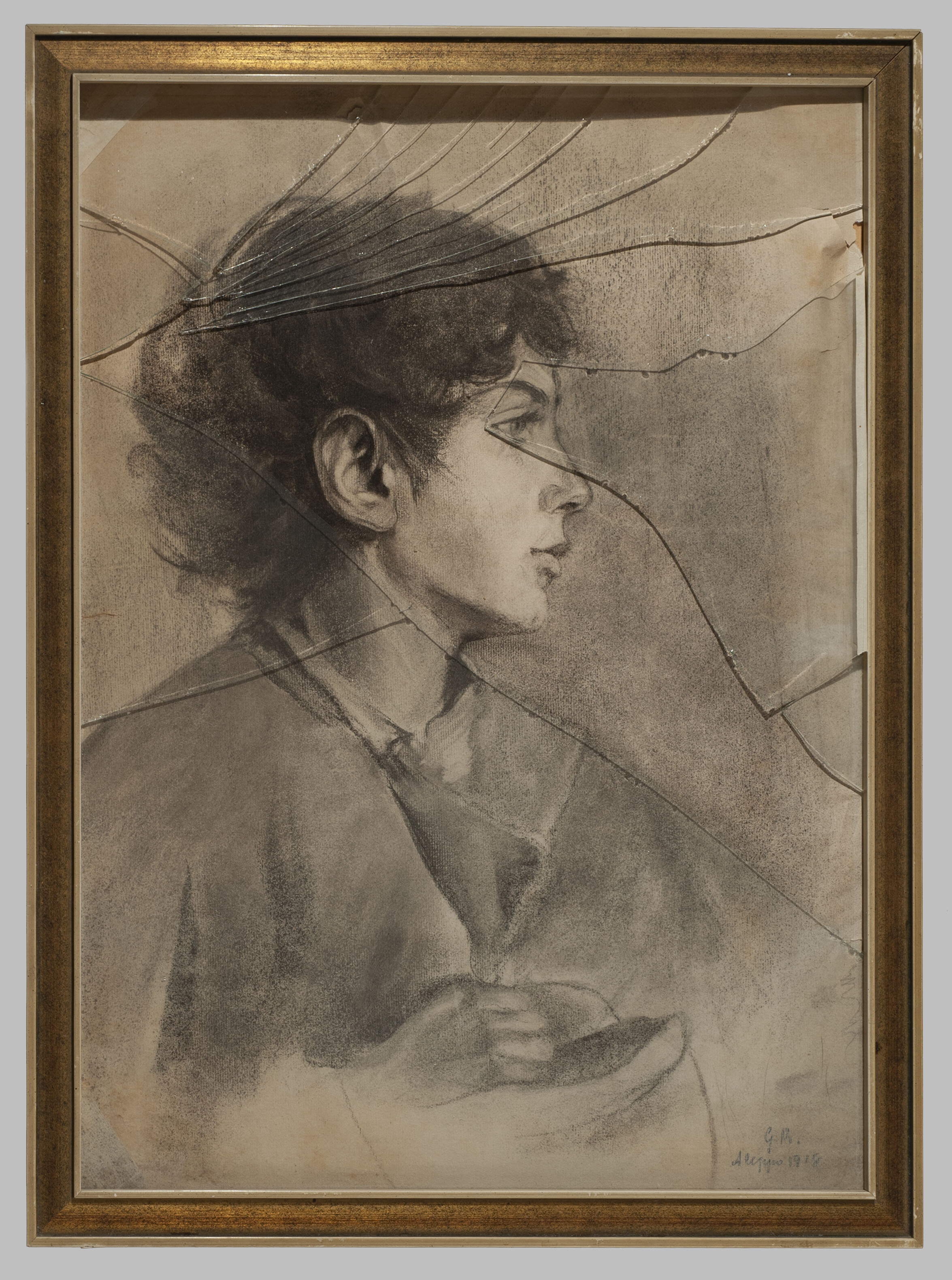 1910 charcoal portrait with surface damage from broken glass frame
