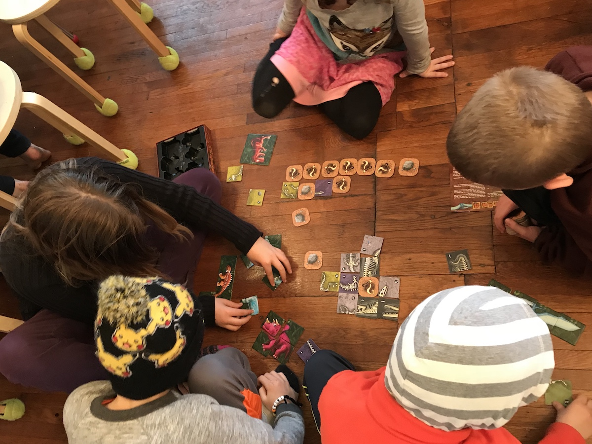 A group of Hawkinals exploring prehistoric life through a game.