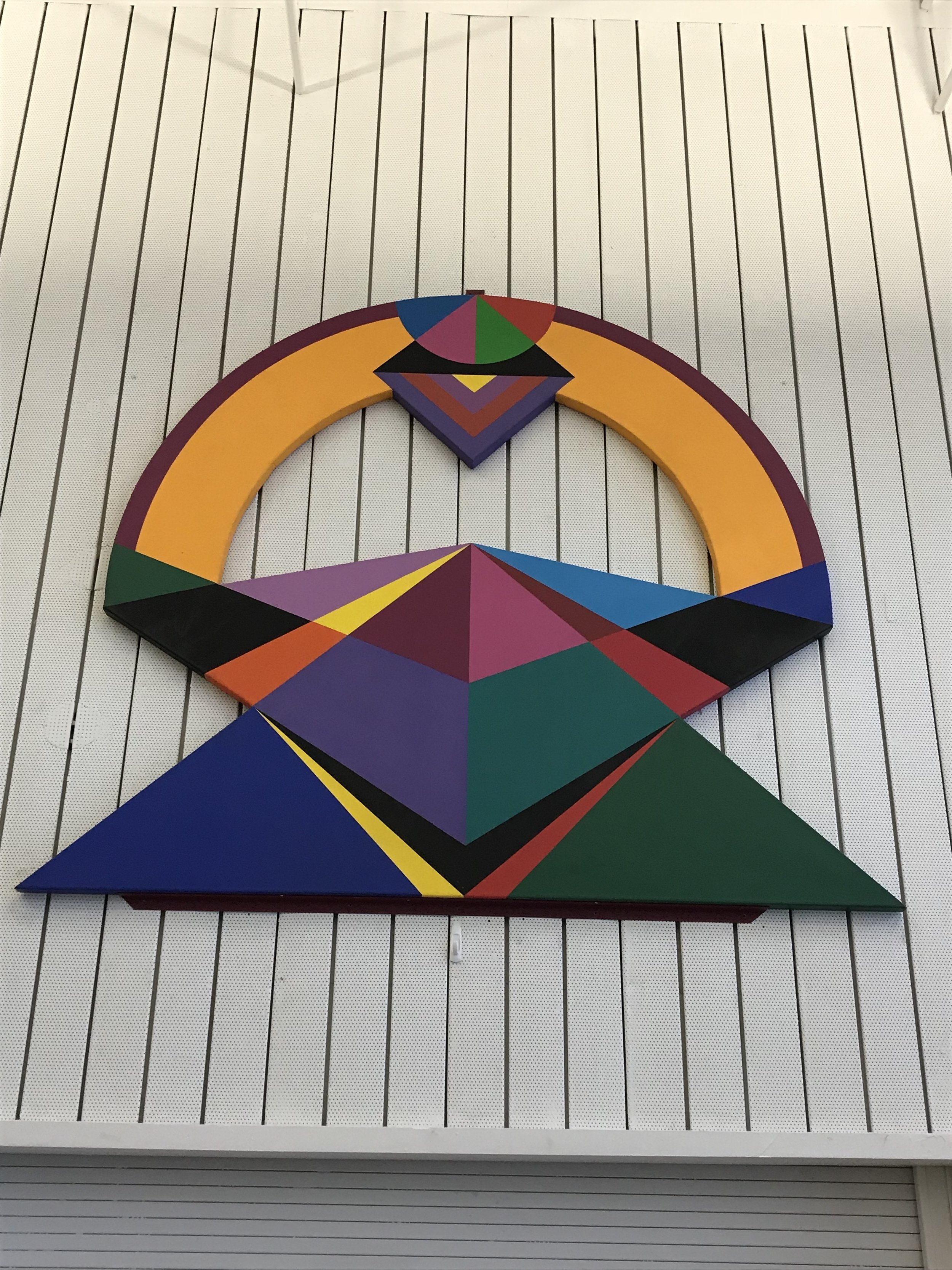 """While they waited for their tour, Cardinals 2 and the Hawks examined this piece together with parent volunteer and art educator, Jodi Kushins. They came up with some meaningful interpretations of what at first appeared to be just a colorful collection of geometric shapes. We learned later the piece is called, """"Giza"""" which fit some of our ideas more easily than others."""