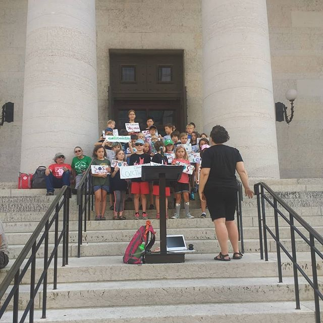 So very proud of our kids. They took the bus downtown to the Statehouse to open the Columbus Climate Strike with song.