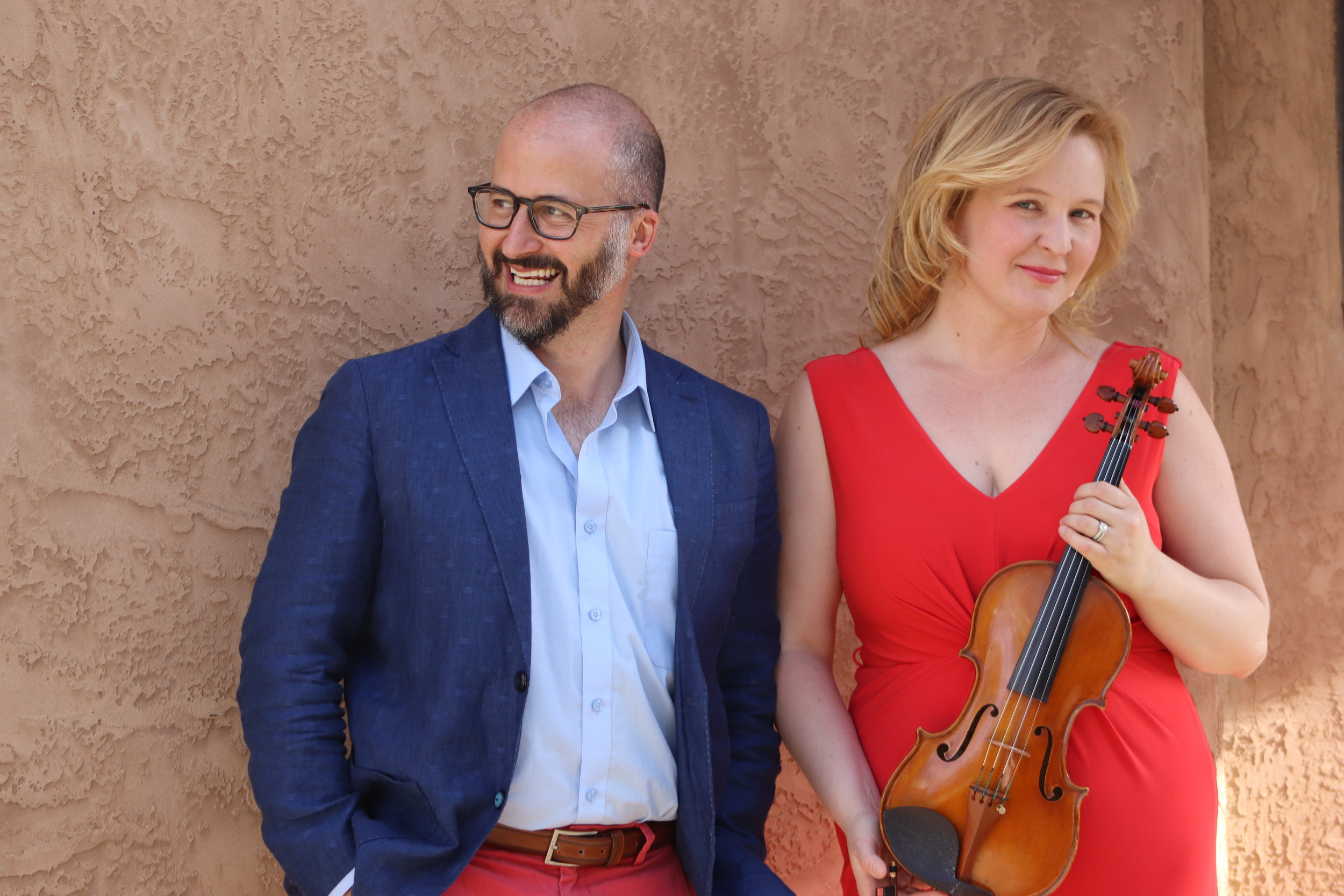 The Young Tiranno Duo was formed in 2018 after many years of performances together in opera and musical theater productions. Violinist/pianist Elizabeth Young-Tiranno and tenor John Tiranno, equally accomplished in their individual careers, have now joined forces as a duo to perform their unique and varied repertoire. Most recently heard in New York and New Mexico, they are the curators of the Las Palomas Concert Series in Santa Fe, now in its second season. Recently married, they make their home in Santa Fe but travel frequently for performances across the country.