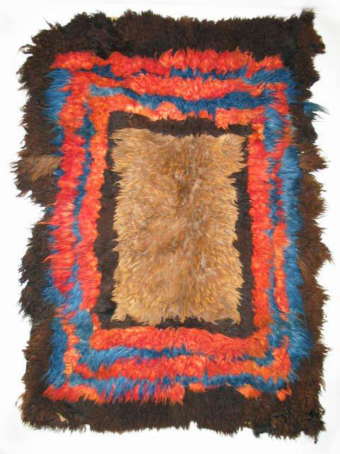 The Karl-Heinz Breuss Kirghiz pieced skin rug has a centre panel which is widely regarded as being made from bear skin.Collection : Karl-Heinz Breuss.