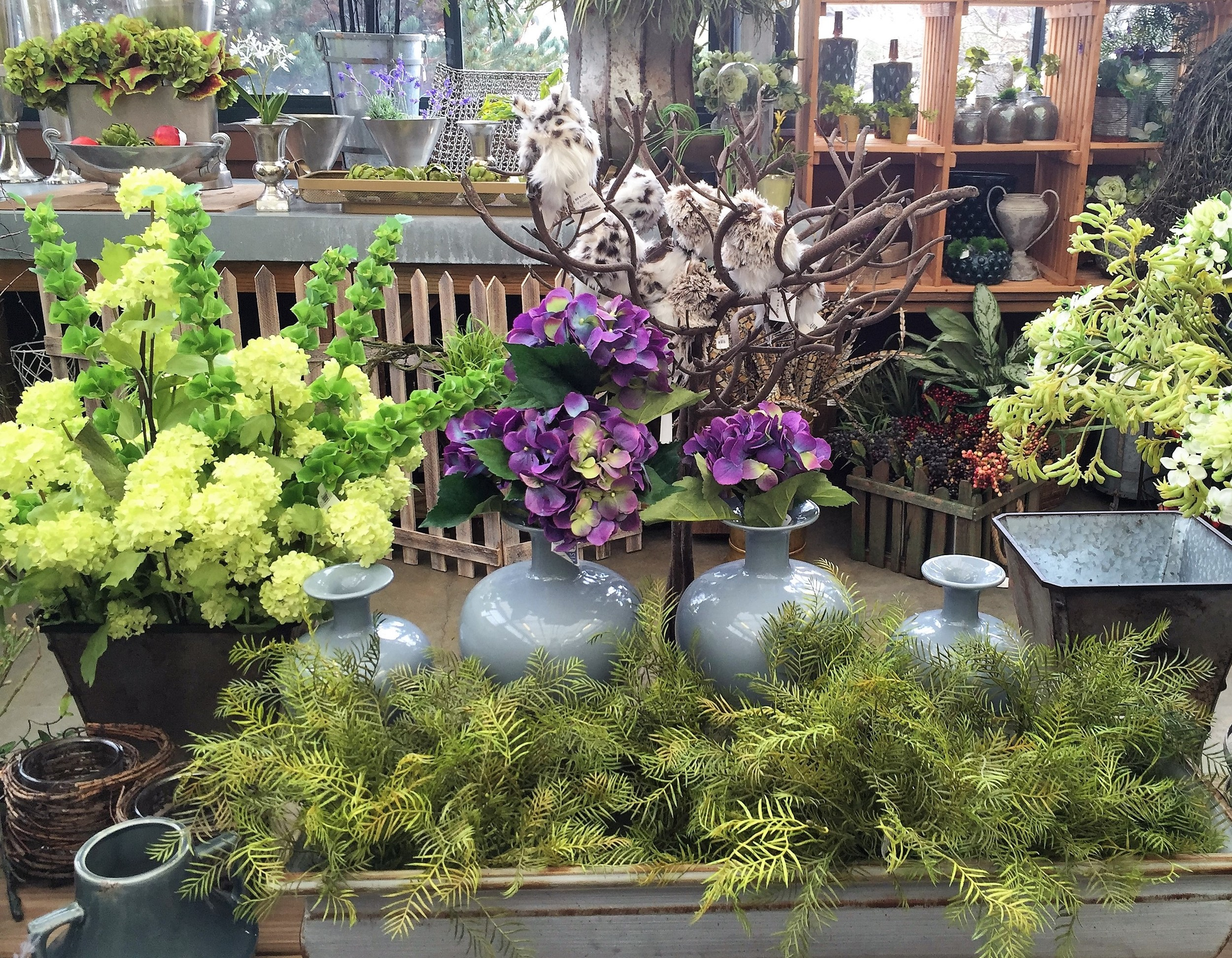 Hydrangeas, viburnum, and frothy ferns combine for a cottage look.