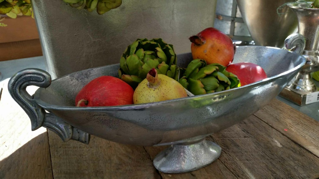 A classic bowl of artificial fruit is the perfect centerpiece for your table.