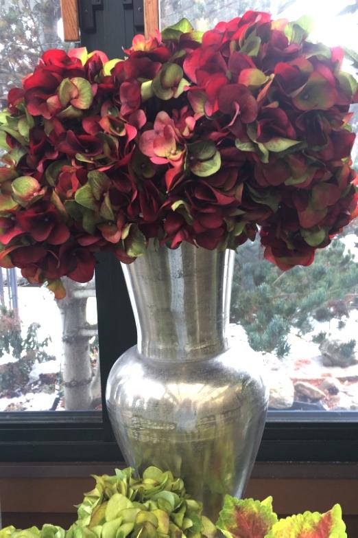 Burgundy hydrangeas in pewter vase. Elegant and colorful..