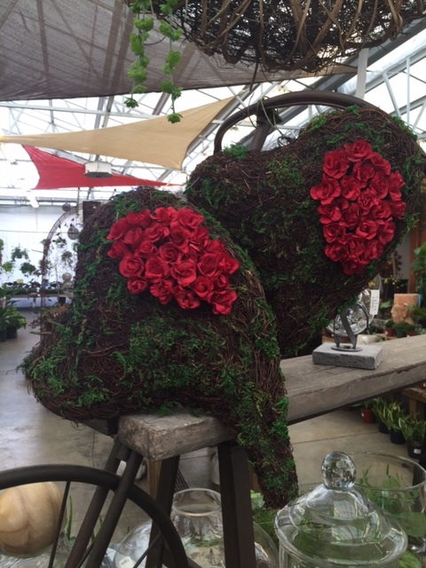 Moss covered hearts with red silk roses
