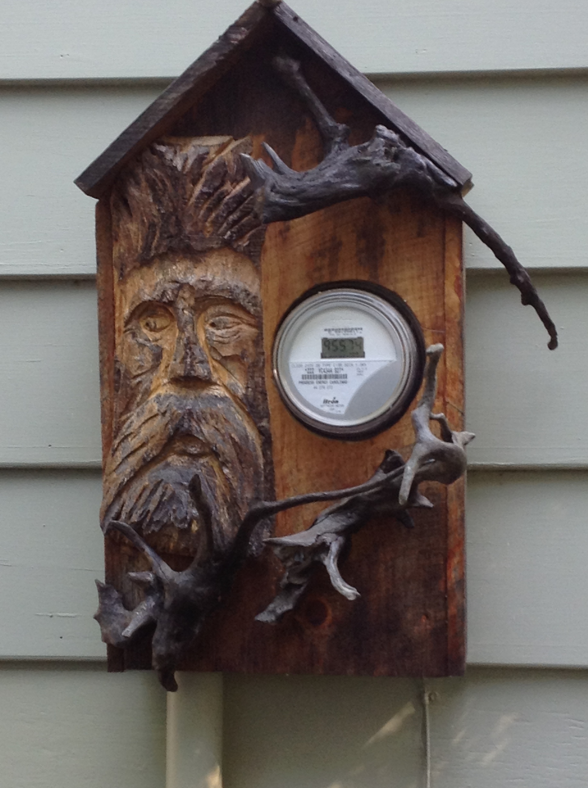 A clever and adorable disguise for the electric meter.