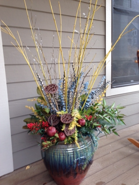 Yellow twig dogwood, eucalyptus, seed pods make a fun winter container.