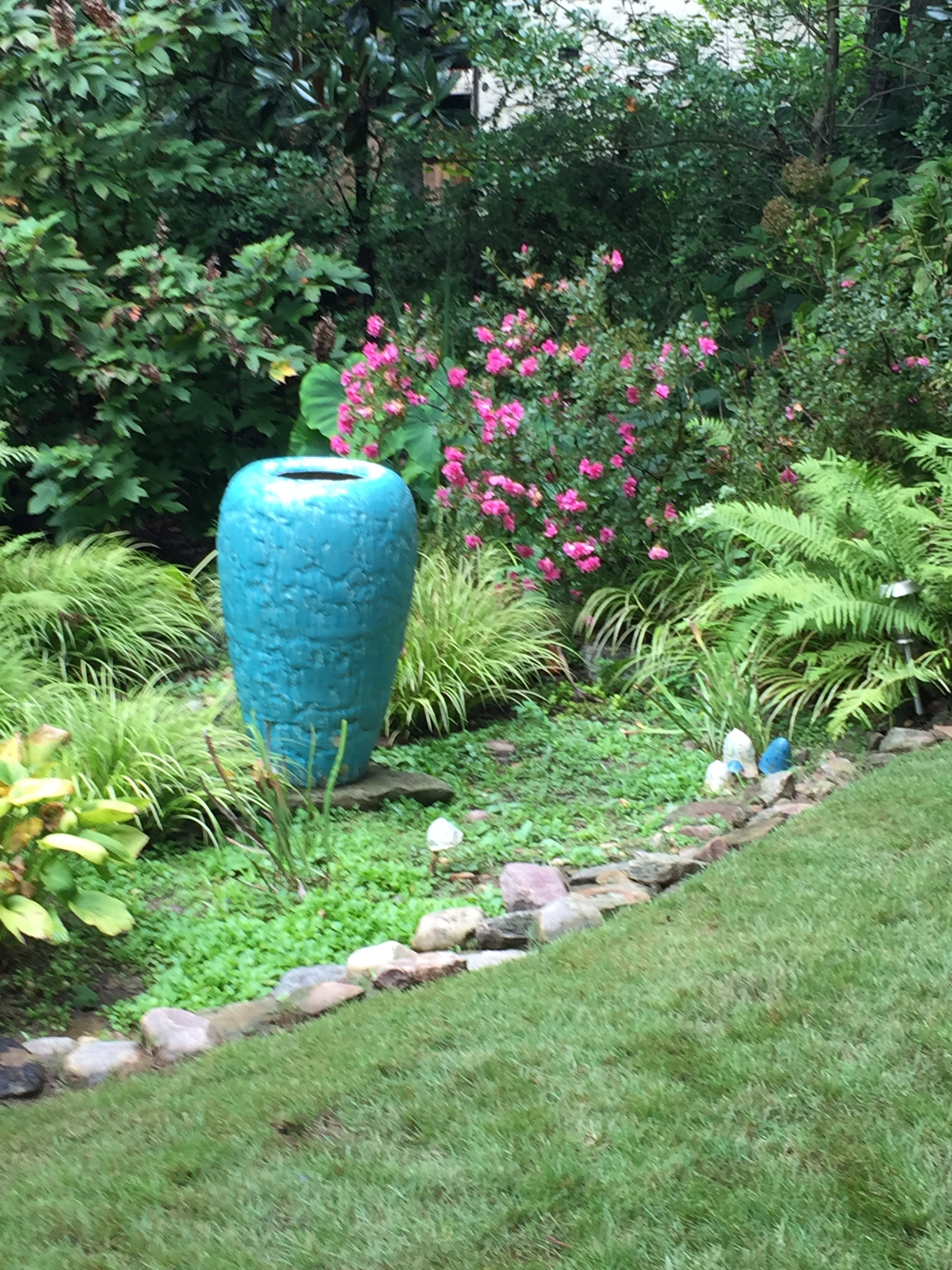 Colorful containers matched the blue frog elsewhere in the garden.