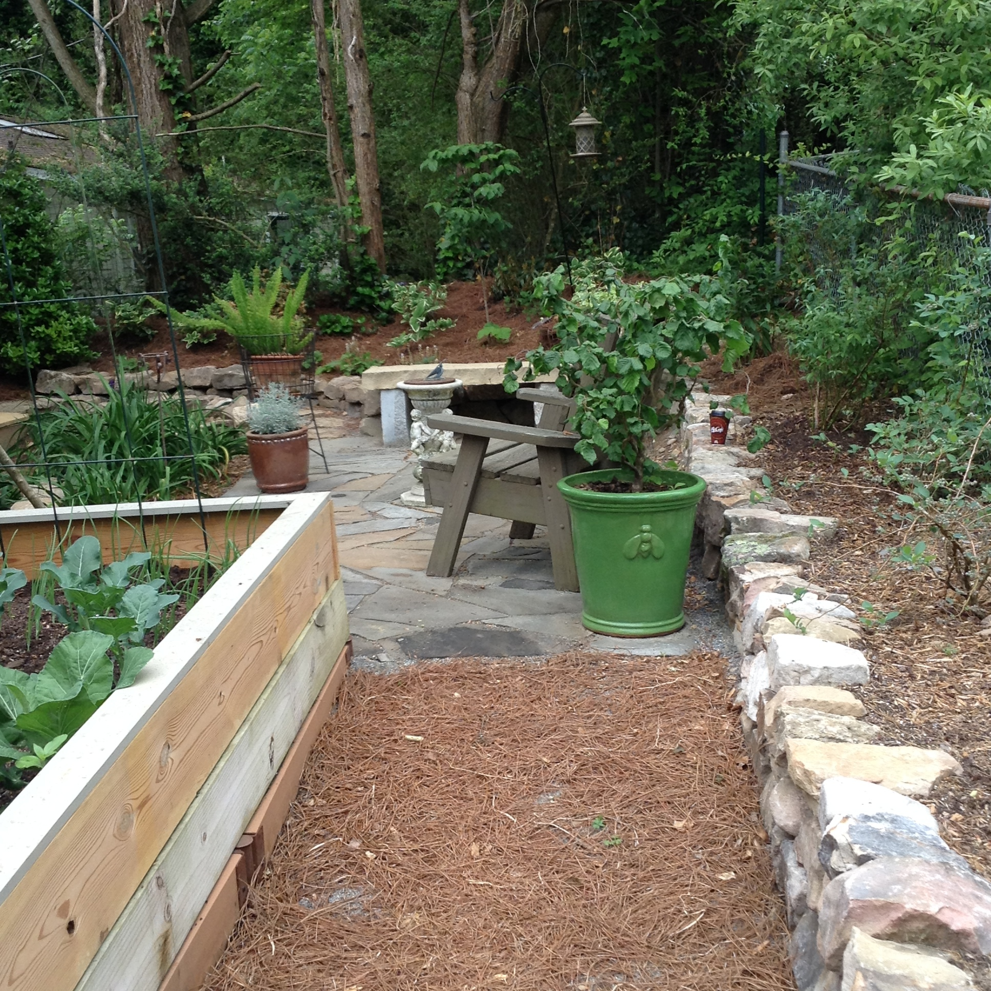 The perfect place to sit after weeding the garden, or enjoy an evening near the fruits of your labor.
