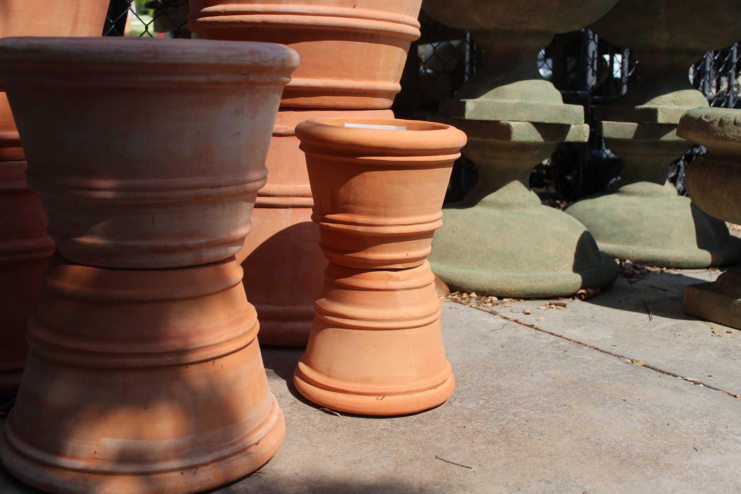Terracotta pots are loved for their simple look, and neutral colors. They're best moved indoors for the winter, where the non-glazed clay won't break or crack.