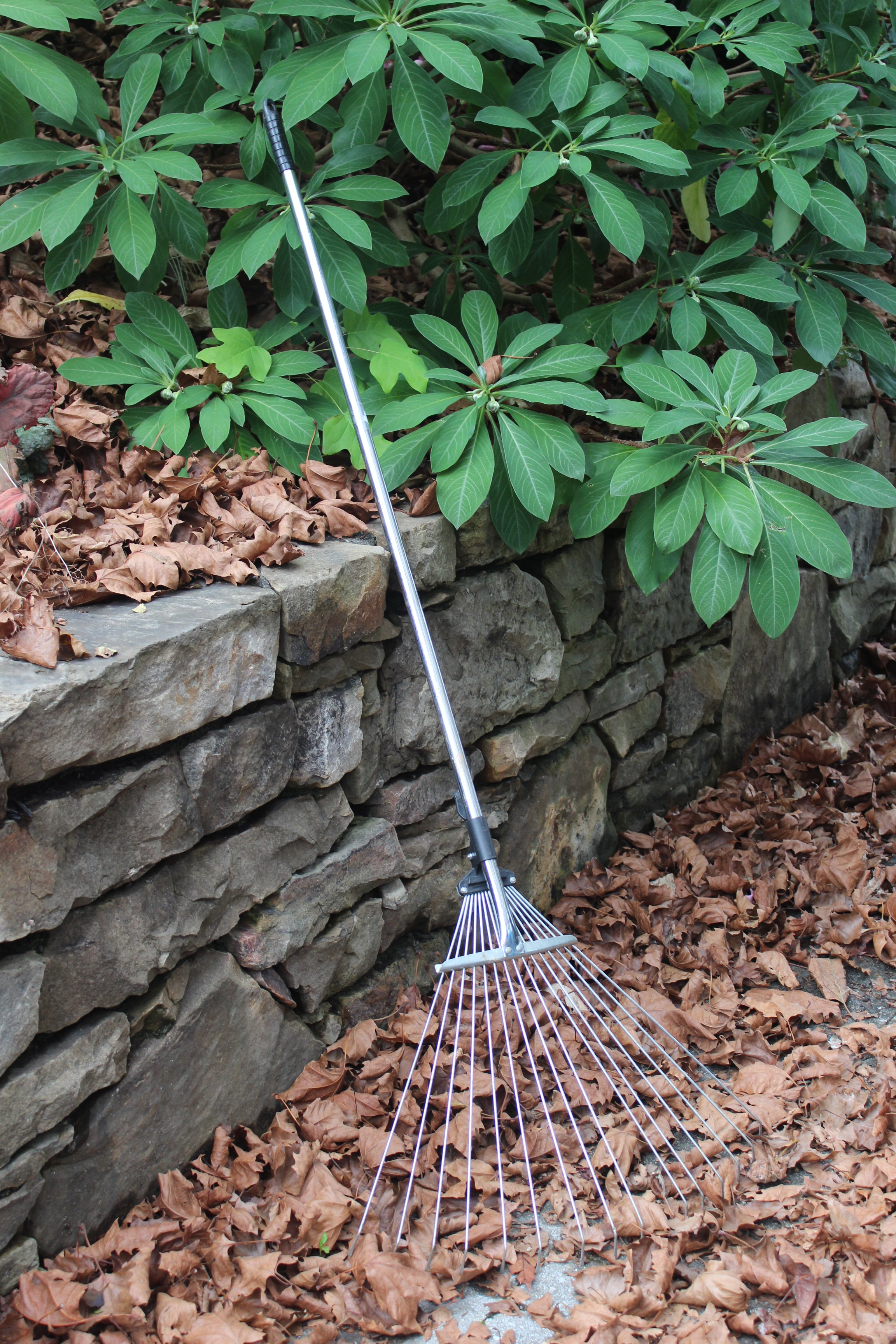 The stainless steel collapsible rake adjusts to fit many jobs.