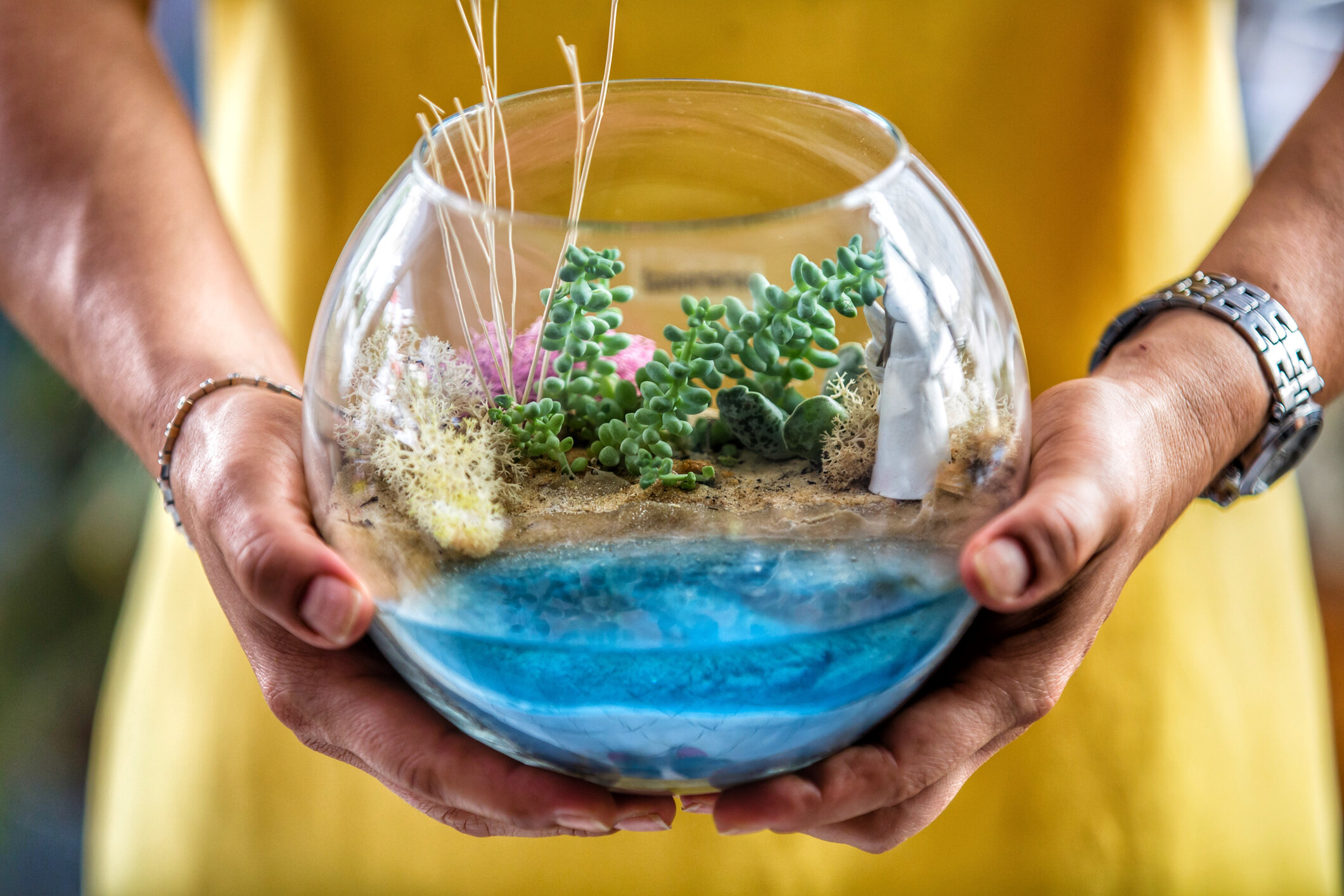 Use colorful blue stones or sand to create the illusion of water.