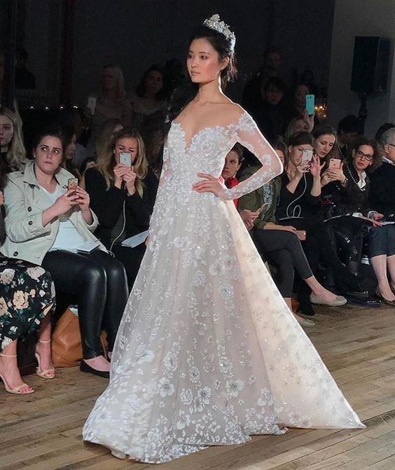 Photo via Haute Bride | Gown by Hayley Paige
