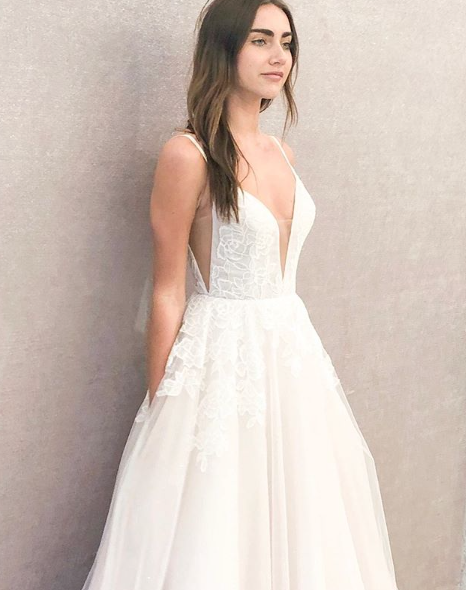 Gown by Blush by Hayley Paige.