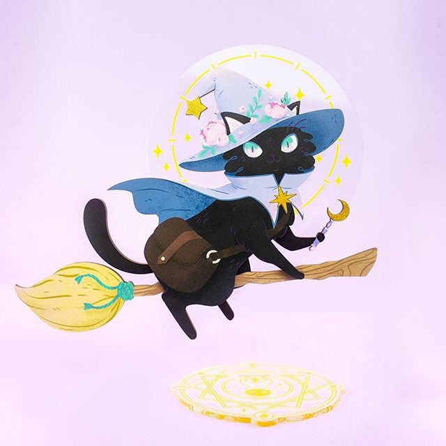 Flying her way through the stars ✨  This laser cut wood and acrylic desk toy was from the amazing collaboration I had with @stipplepopshoppe. Stella has lots of fun details such as the sparkly accents on her wand and hat, a kitty witch summoning circle, and overall incredible quality! She comes disassembled in a lovely box and would make a great desk buddy 😊