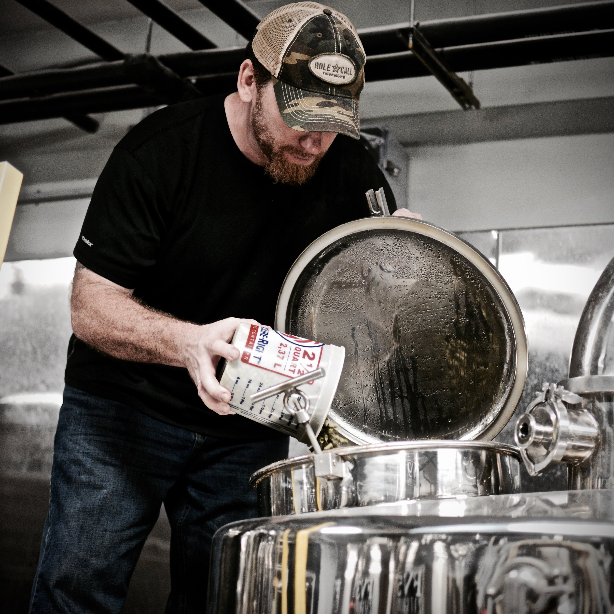 Hop Head Dave Pappas pours fresh hops into the kettle for the inaugural batch of the  Black Ale Project .   Photo by Medusa Brewing Company