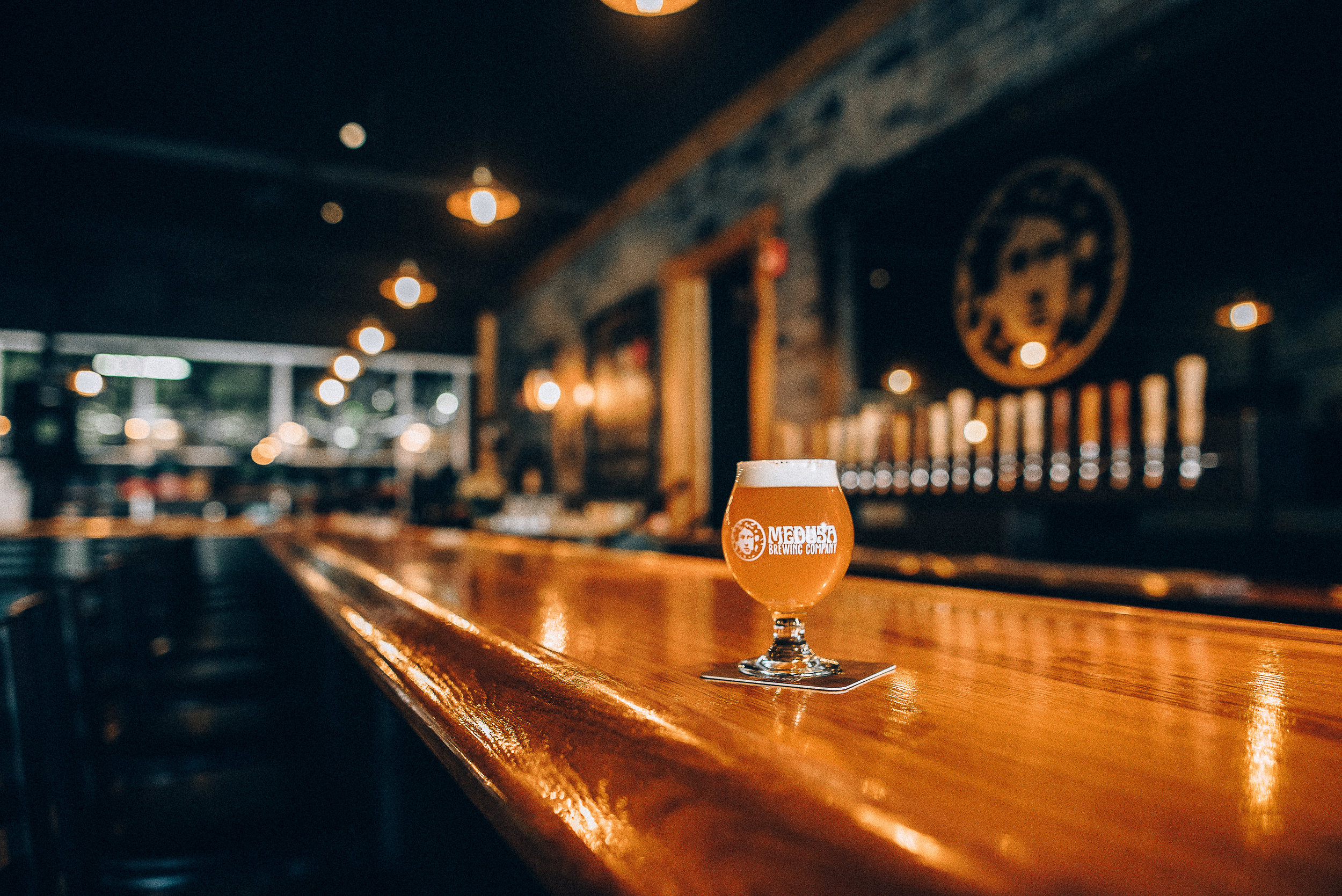A view of the taproom bar at Medusa Brewing Company in Hudson, MA.   Photo by Elise Meader of  elisemeaderphotography.com
