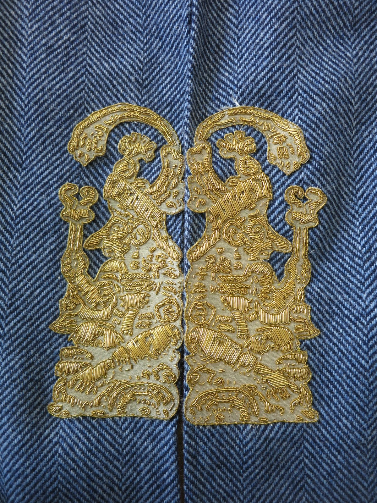A metal thread embroidered sample at Hand & Lock