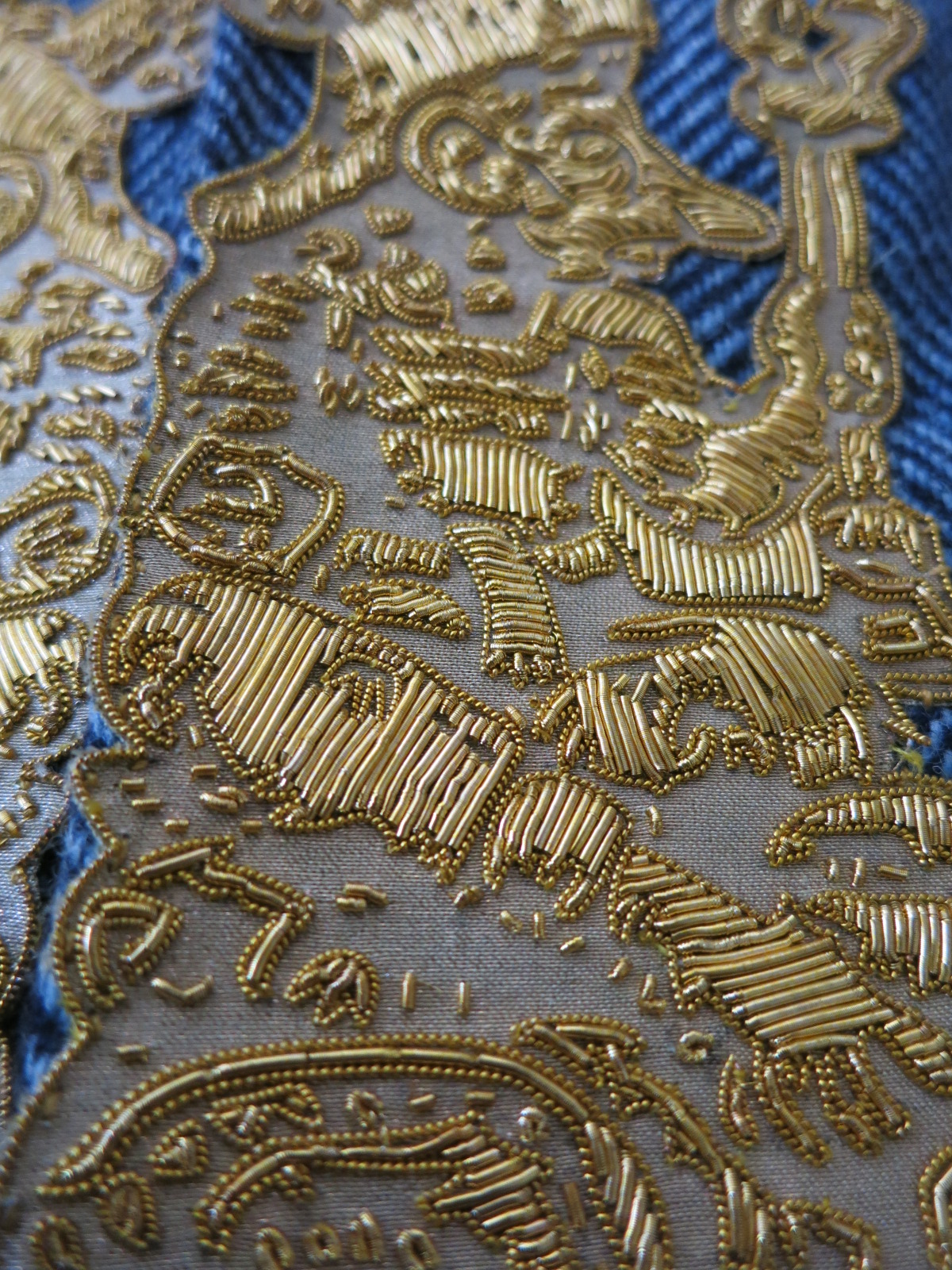 An metal thread embroidered sample at Hand & Lock