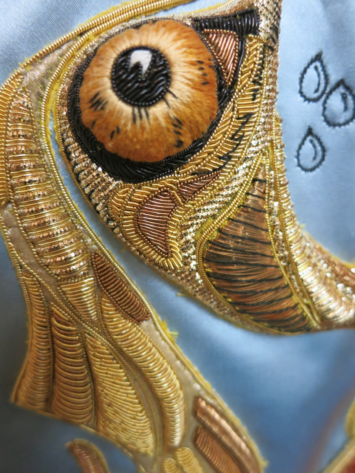 A detail of an embroidered garment in a Hand & Lock Collection