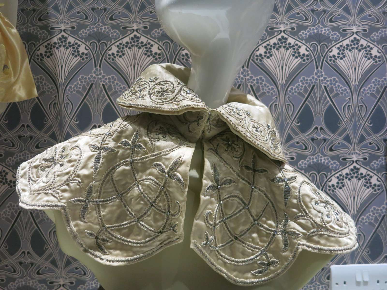 Liberty in Fashion exhibition at the Fashion & Textile Museum, Bermondsey, London 2015. A 1895 satin collar embroidered with white floss, crystal beads and pastes.