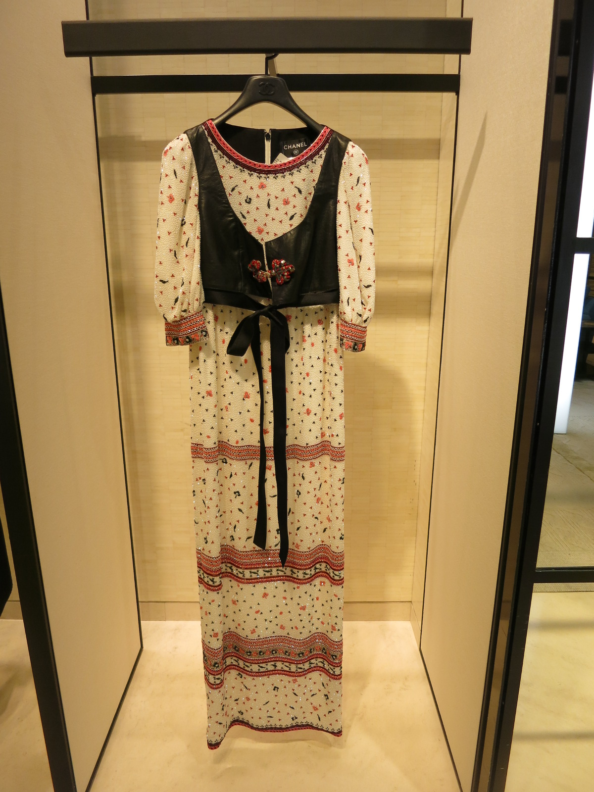 Coco Chanel 31 rue Cambord, Paris. An embroidered gown from a 2015 Chanel collection.