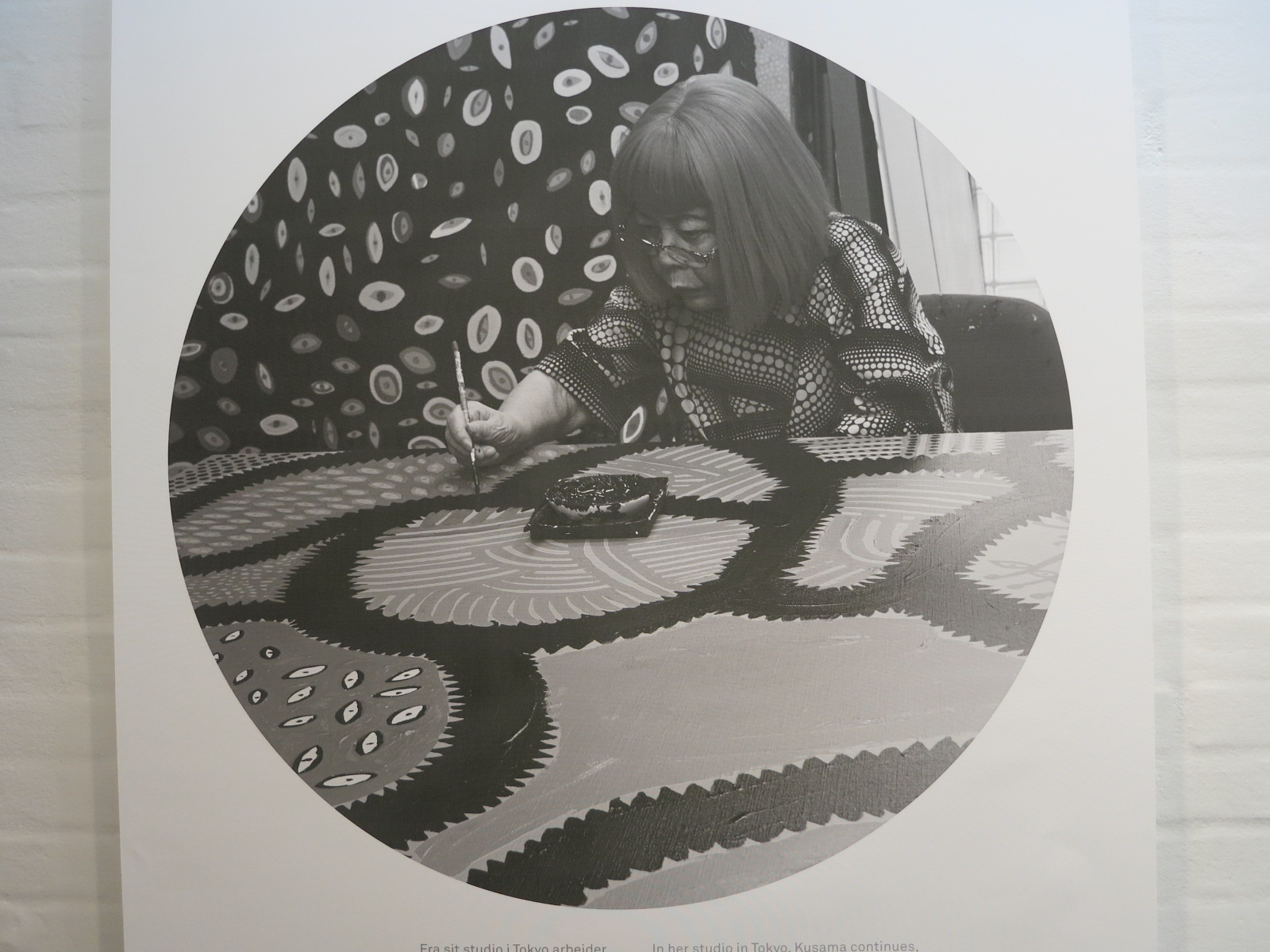 A recent photograph of Yayoi Kusama working on a painting for her 'My Eternal Soul' series