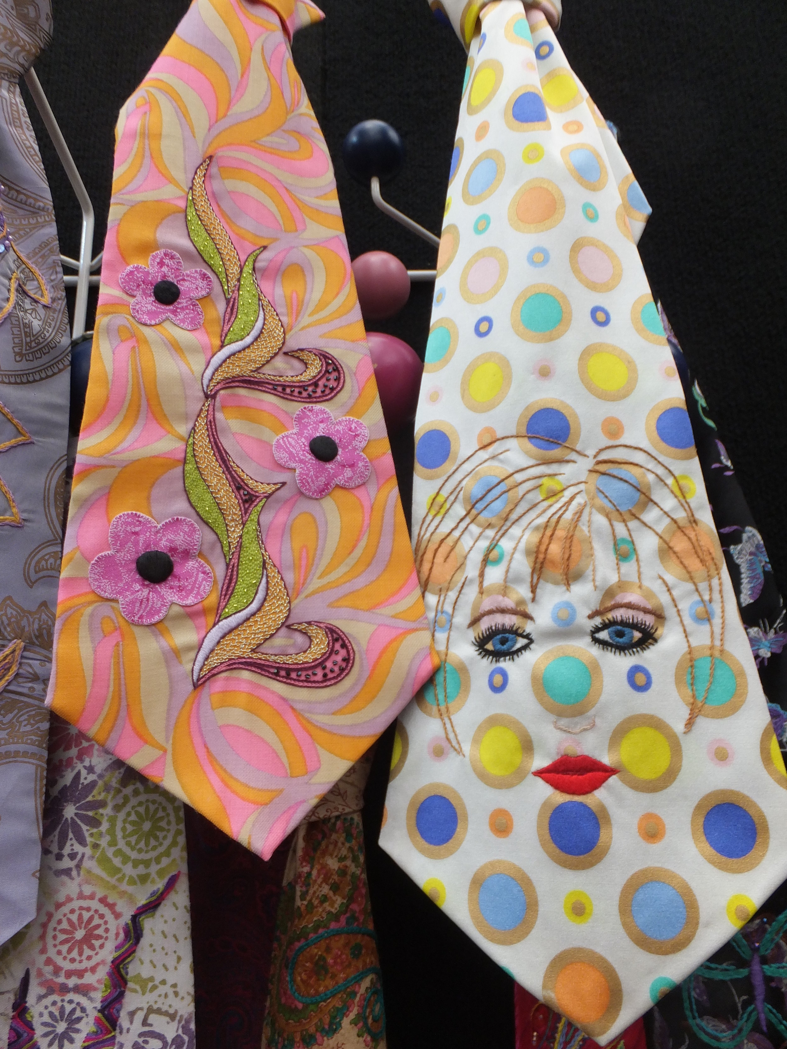 The tie on the left is by Joan Dunn and the tie on the right is by Val Tomlins - 2 of many ties in the Carnaby Street 1960s installation for the Embroiderers' Guild N.S.W's feature space in the Craft & Quilt Fair, Sydney June 2016