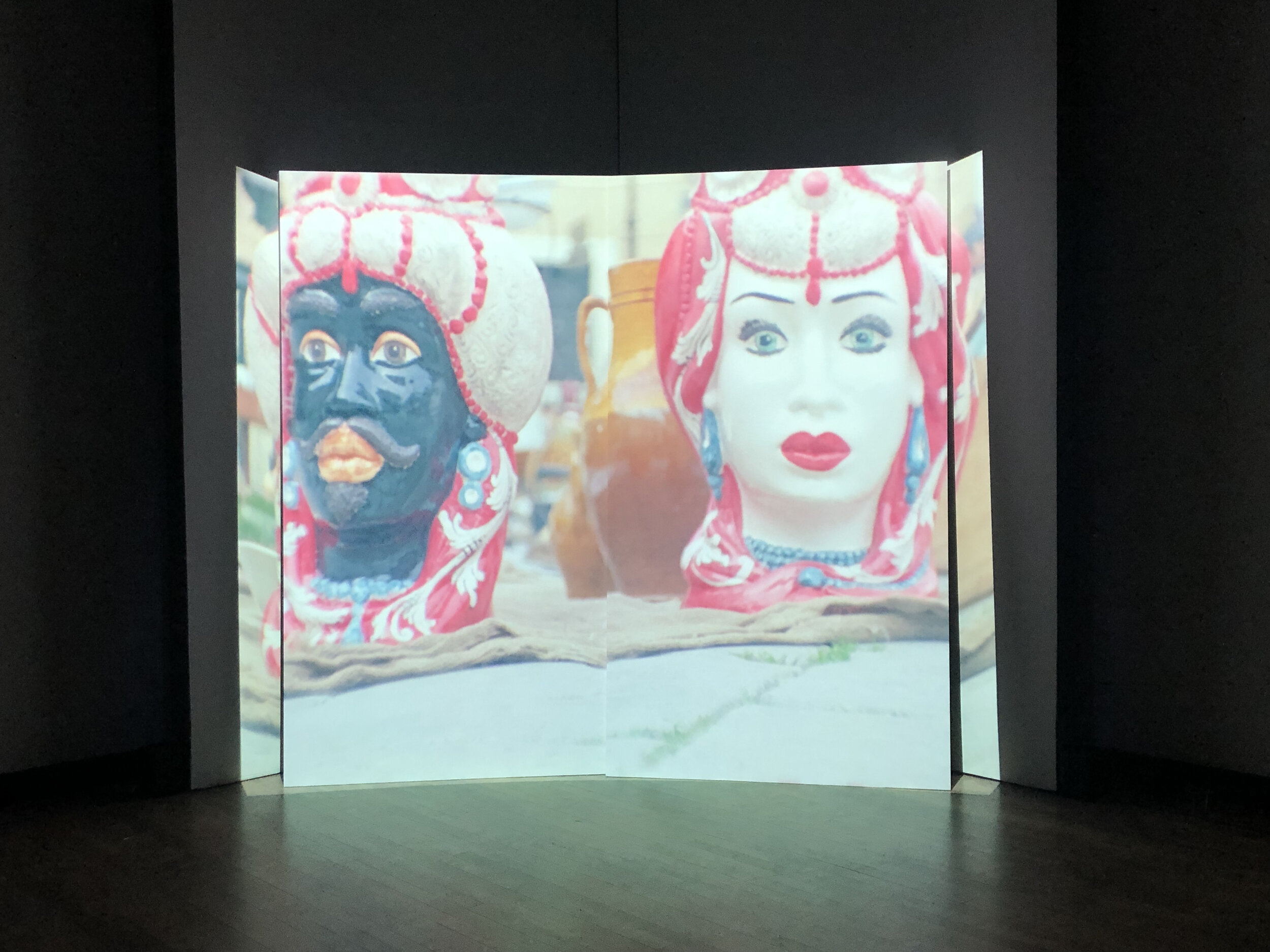 installation view at the Rubenstein Arts gallery. projection onto a bifurcated screen.
