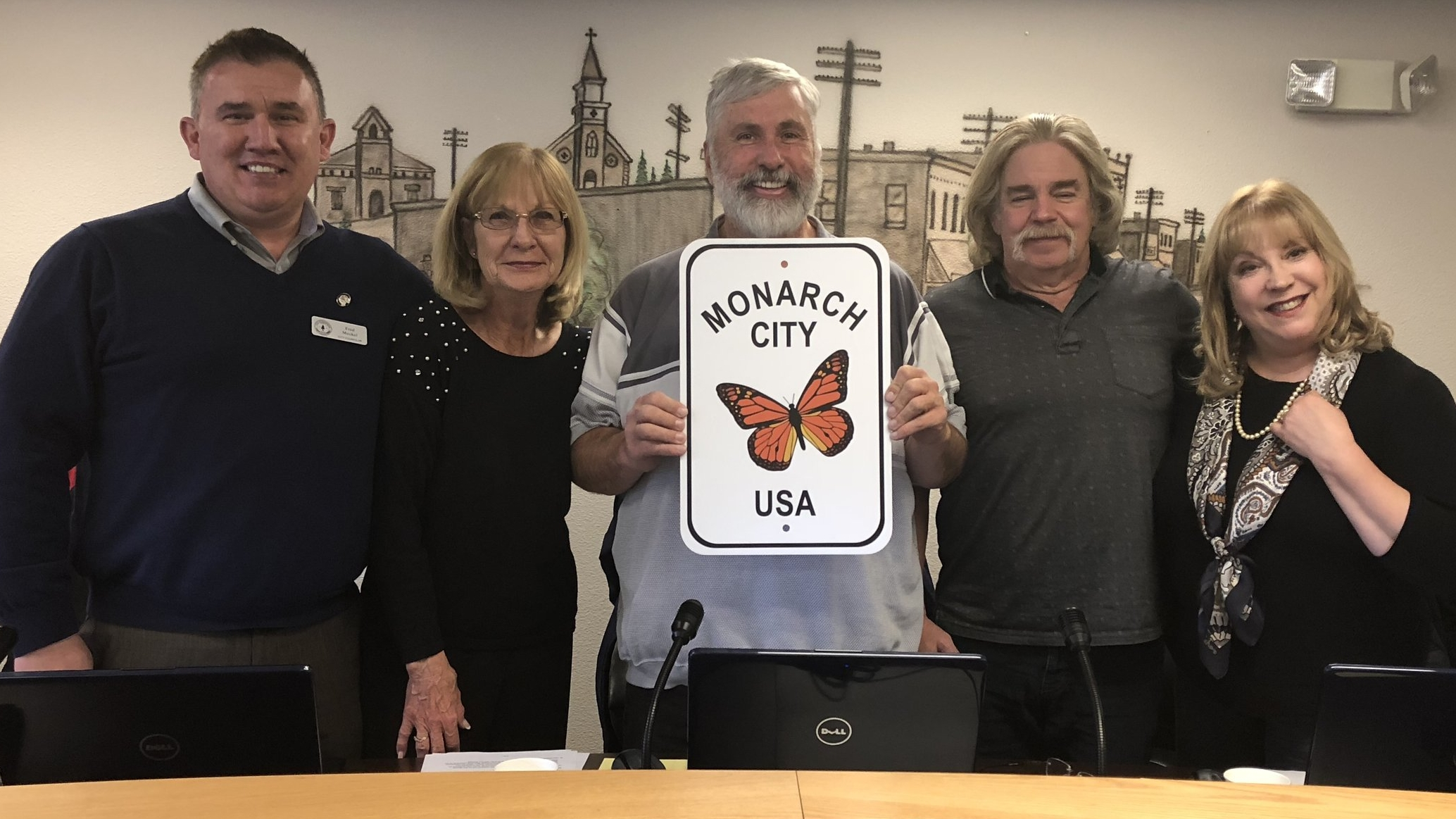 Leaders of the City of Rathdrum, the first and only member of Monarch City USA in the state of Idaho posed with their new sign.  Left to right: Council member Fred Meckel, Council Member Paula Laws, Rathdrum Mayor Vic Holmes, Council Member Darrell Rickard, Council Member Debbie Holmes
