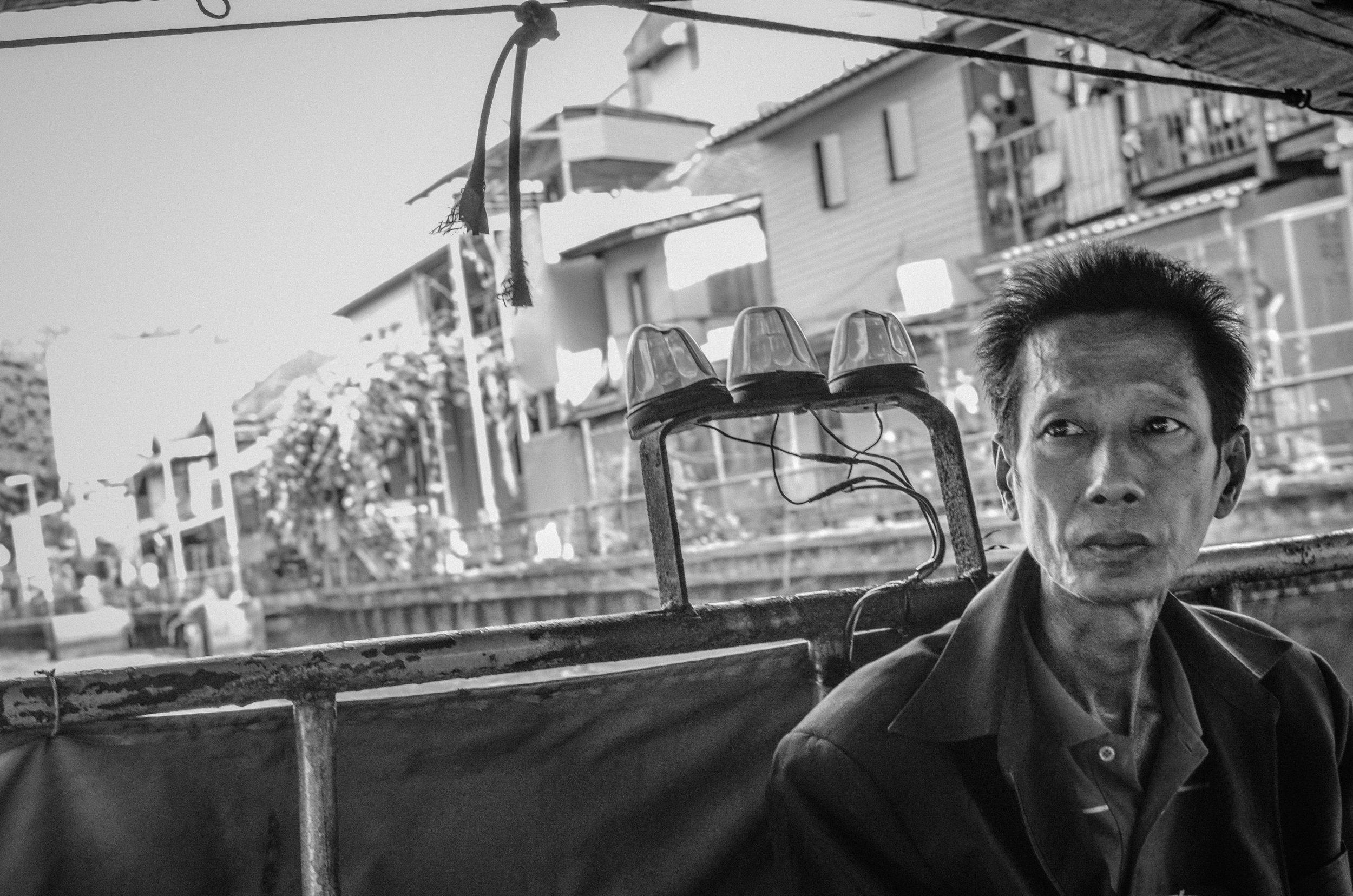 Man in boat, Bangkok, Thailand