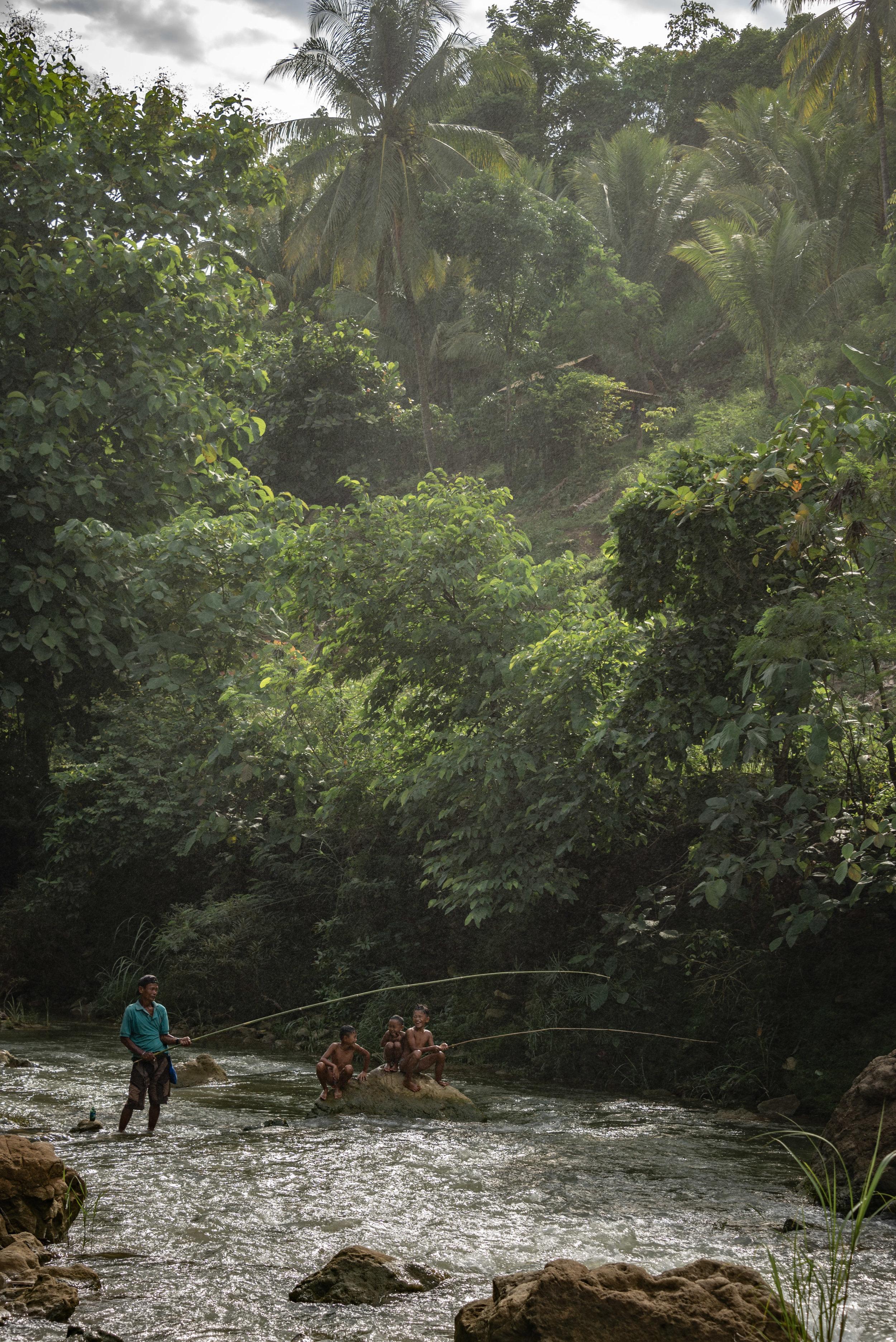 Fisherman and his kids, Niludhan Falls, Negros Island, Philippines