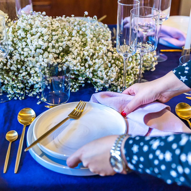 Marie the owner and creative director of A La Table styling her beautiful Bryon set entree plates.